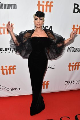 Lady Gaga opted for a fitted black Armani Privé gown with a sheer black veil at the premiere of 'A Star is Born' at the Toronto International Film Festival. (Photo: WENN)