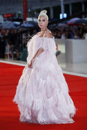 Lady Gaga stunned at the 'A Star is Born' screening in a full-length pink feathered ball gown designed by Valentino. (Photo: WENN)