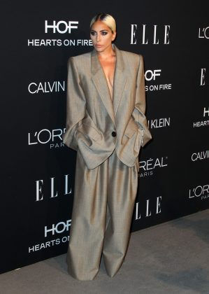 Lady Gaga channeled the 90's Working Girl look in an oversized Marc Jacob power suit at ELLE's 2018 Women in Hollywood event. (Photo: WENN)