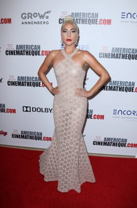Gaga attended the 2018 American Cinematheque Award wearing a sheer cream halter neck gown designed by Alïa. (Photo: WENN)