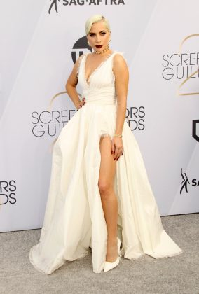 Lady Gaga wore a show-stopping white Dior gown with a dramatic leg slit to the Screen Actors Guild Awards 2019. (Photo: WENN)