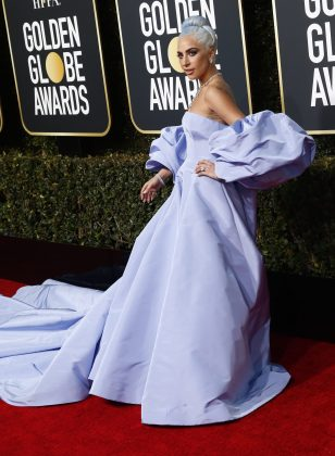 Lady Gaga turned up to the Golden Globes wearing a Valentino Couture levanted gown with dramatic train. (Photo: WENN)