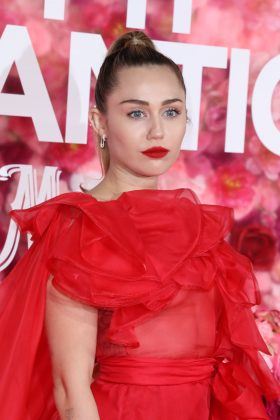 "Miley Cyrus has stated that she's ""fluid"" when it comes to her sexuality. In an interview with Paper magazine, the singer said she doesn't really ""relate to being a boy or a girl."" She also stated that she doesn't put those labels on her romantic partners. (Photo: WENN)"