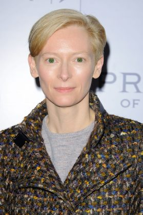 "Tilda Swinton has stated in interviews that she's not sure if she could really ever say she is a girl, and that she went through a period of ""being a boy"" for a long time. She now says that as an adult, she is ""probably a woman."" (Photo: WENN)"