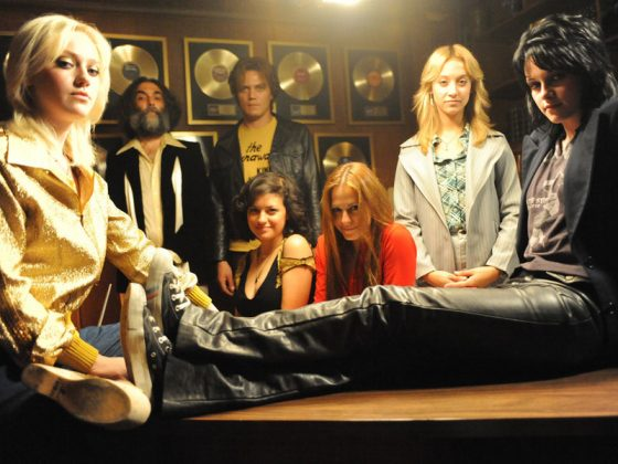"Viewers expecting an in-depth biopic will be disappointed. However, ""The Runaways"" is as electric as the band's music thanks to strong performances from Dakota Fanning and Kristen Stewart. (Photo: Release)"