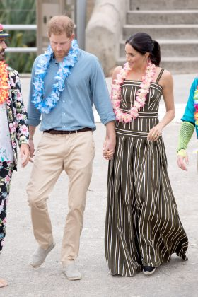 Meghan Markle's striped chic maxi dress by Martin Grant showed off a hint of a baby bump during the royals' Australian tour. (Photo: WENN)