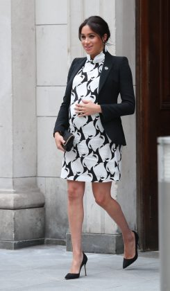 Meghan wore a black and white printed Azzura mini dress with a blazer while observing the International Women's Day. (Photo: WENN)