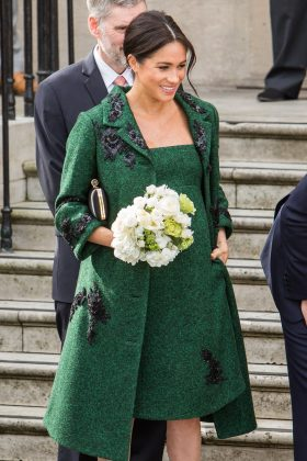 Meghan Markle visited the Canada House in London wearing a forest green Erdem coat accented with black embroidery. (Photo: WENN)