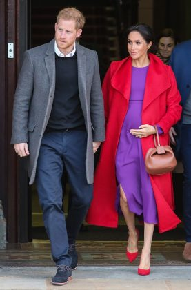 Meghan Markle's unexpected red and purple clashing outfit channeled one of Princess Diana. (Photo: WENN)