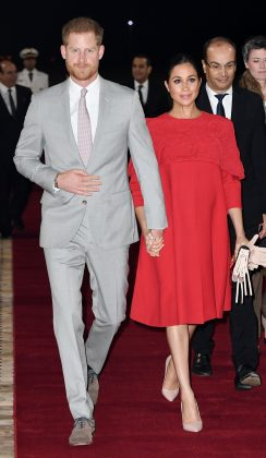 Prince Harry's wife was a vision in red while wearing a cape dress by Valentino as she starter her Moroccan royal tour. (Photo: WENN)