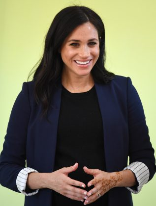 Meghan Markle stepped out wearing a long navy blazer with the striped cuffs showing for a day of royal engagements in Morocco. (Photo: WENN)