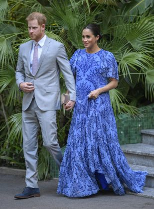 Meghan Markle wore a show-stopping light-blue dress with floral print by Carolina Herrera to meet King Mohammed VI in Rabat. (Photo: WENN)