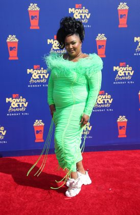 We don't know what we hate more—if Lizzo's pupil-killer dress or her chunky, glittery shoes. (Photo: WENN)