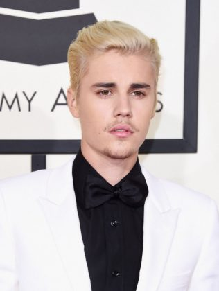 "Justin Bieber and Usher were sued by Devin Copeland, who claimed their song ""Somebody to Love"" copied his track of the same name. The case was dismissed. (Photo: WENN)"