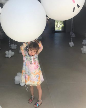 She's a big girl, but not bigger than those birthday balloons. (Photo: Instagram)