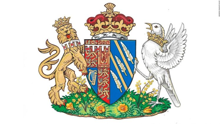 Because she is estranged from her dad and he didn't attend the wedding, the coat of arms traditionally given to the bride's father was created specifically for Meghan. (Photo: WENN)