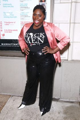 "Brooks stunned at the ""Choir Boy"" opening night wearing a pair of sequin-covered black trousers and a shiny silk pink blazer on top of a graphic tee. (Photo: WENN)"