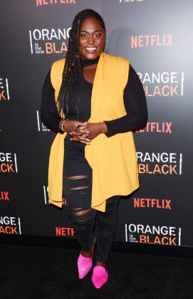 "Danielle Brooks let her magenta shoes and yellow maxi vest do the talking at the 2018 Emmy event for ""Orange Is The New Black."" (Photo: WENN)"