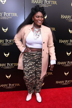 """Brooks went for an eclectic look at the """"Cursed Child"""" opening night with a high-waisted camo jogger pants and a blush knee-length coat combo. (Photo: WENN)"""
