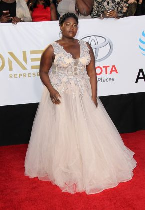 The OITNB star attended the 49th NAACP Image Awards delivering such a pretty princess moment in a pink embellished tulle gown. (Photo: WENN)