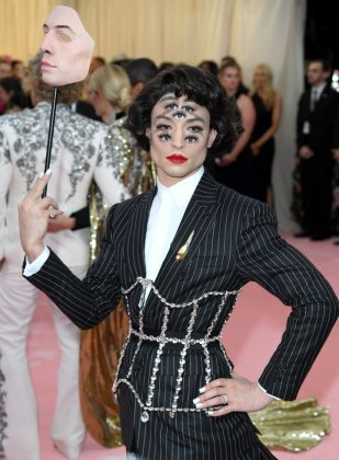 Ezra went for a bold look at the 2019 Met Gala in a custom Burberry suit, overshadowed by the multiple sets of eyes painted on his face. (Photo: WENN)