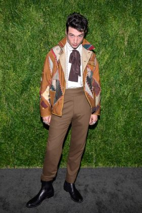The actor worked his best angles at the 15th Annual CFDA Vogue Fashion Fund awards in an eclectic patchwork coat completed with a brown bow. (Photo: WENN)
