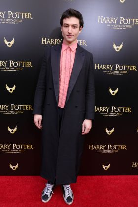 The Fantastic Beasts star attended the Cursed Child Broadway opening rocking an ankle-length black blazer and salmon ruffled button-up. (Photo: WENN)
