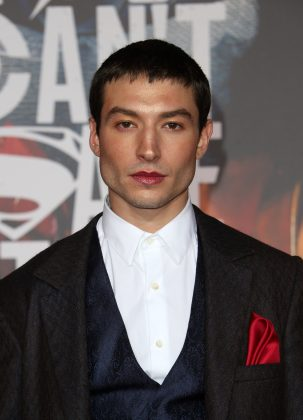 Miller joined his Justice League peers at the premiere of their movie wearing a red satin pocket square that matched his lip gloss. (Photo: WENN)