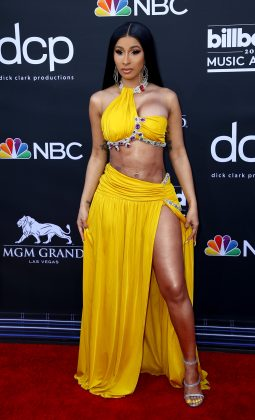 The rapper looked like a winner at the 2019 Billboard Music Awards in a yellow crop top and skirt, showing off her insane abs. (Photo: WENN)