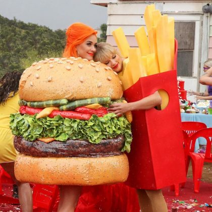 "A neon orange haired Katy rekindled her friendship with Taylor in the music video for ""You Need to Calm Down."" (Photo: Instagram)"