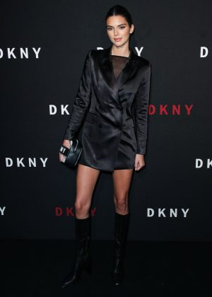 Kendall Jenner rocked a black satin blazer and matching knee-high boots at DKNY's 30thbirthday party. (Photo: WENN)