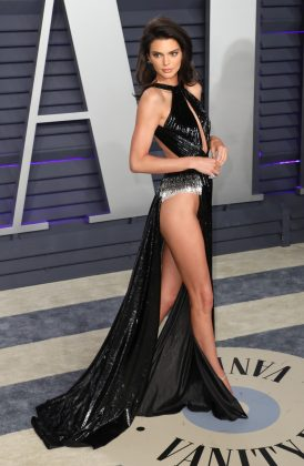 Kendall Jenner showed off her at the Vanity Far Oscar party legs in a shimmery black gown featuring daring high-slits. (Photo: WENN)