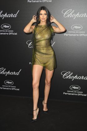 Kendall Jenner was aware we could see through her gauzy, metallic green dress at the Chopart Secret Night in 2018 Cannes. (Photo: WENN)