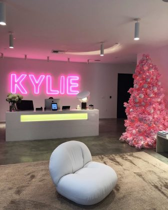 The youngest billionaire had her Christmas tree to match with her big neon signs at Kylie Cosmetics headquarters. (Photo: Instagram)