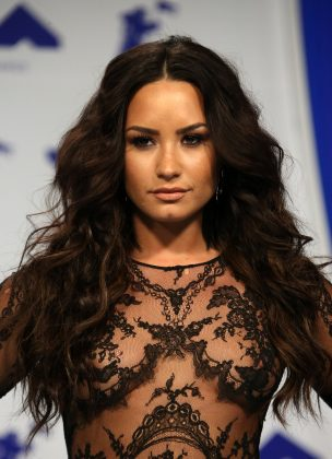 "Demi Lovato took said against Taylor Swift in her feud with Demi's own manager, Scooter Braun. ""Please stop dragging people or bullying them,"" she tweeted. (Photo: WENN)"