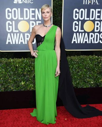 The visible-boning bodice made it look like Charlize Theron's gown was either falling off or incomplete. (Photo: Instagram)