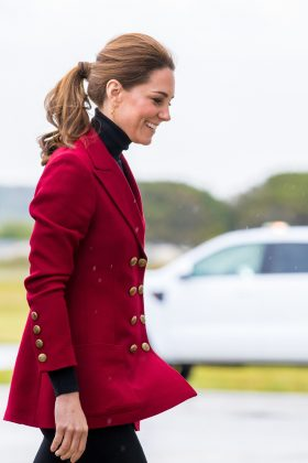 Middleton donned a red blazer with military gold buttons while visiting the Caernarfon Coastguard Search and Rescue Helicopter Base. (Photo: WENN)