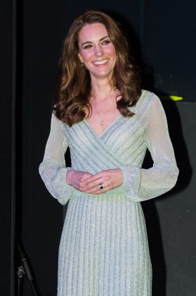 Middleton wore a little more sparkle for an event at Belfast's Empire Music Hall in a mint-colored wrap gown. (Photo: WENN)
