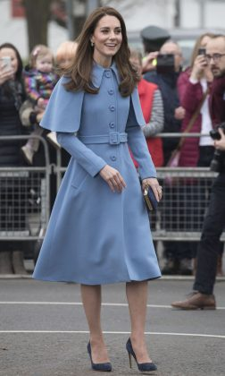 Katherine raised smiles while wearing a light blue cape coat for a walkabout in Ballymena, North Ireland. (Photo: WENN)