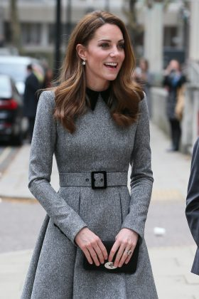 The Duchess visited the Foundling Museum in London, wearing a gray belted coat featuring a black collar neckline. (Photo: WENN)
