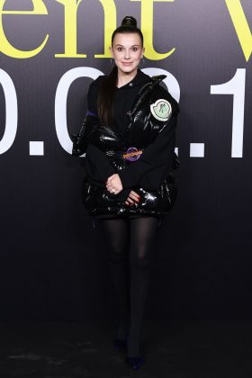 Bobby Brown reflected the youth and diversity of Moncler Genius rocking a black hoodie dress underneath a vinyl jacket, paired with a trendy bubble ponytail. (Photo: WENN)