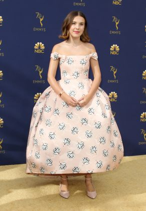 The young actress wore a light-pink floral Calvin Klein number at the 2018 Emmy Awards, paired with matching pointy toed flats. (Photo: WENN)
