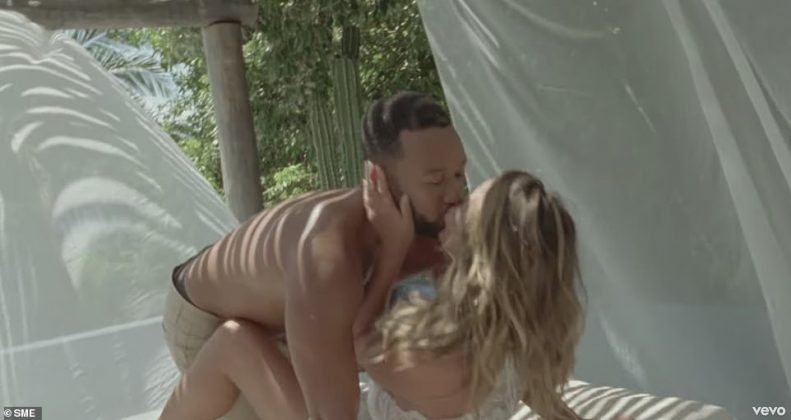 There is no shortage of PDA in the romantic music video (Photo: Release)