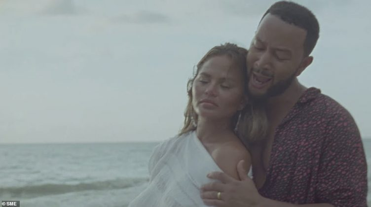 Chrissy Teigen and John Legend have announced they are expecting their third child together in the new music video Wild (Photo: Release)