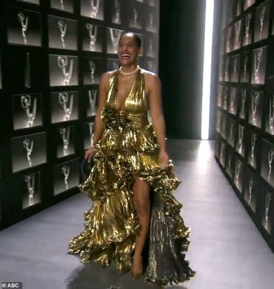 Taking the plunge: Tracee Ellis Ross dazzled in a gold dress with ruffled skirt (Photo: ABc/Release)