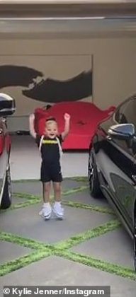 Stormi is jumping up and down on the driveway between two cars (Photo: Instagram)