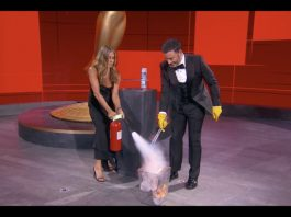 Jennifer Aniston and Jimmy Kimmel extinguish the blaze of an Emmy envelope on fire in a comedy bit from the 2020 Emmy Awards. (Photo: Release/ABC)