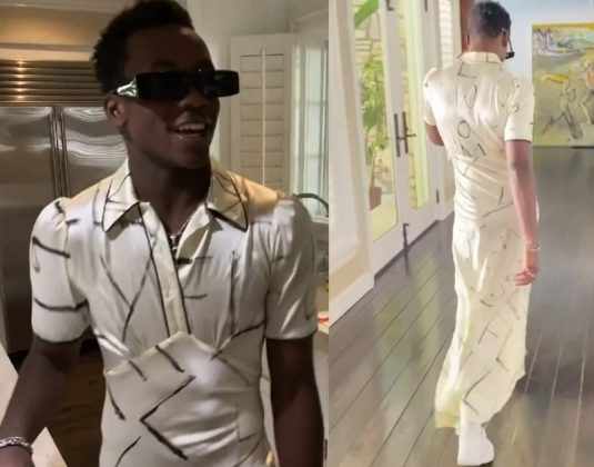 The silky garment was white with black paint stripes and featured a collar (Photo: Instagram)